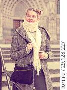 Купить «positive girl teenager in the city in scarf», фото № 29128227, снято 11 ноября 2017 г. (c) Яков Филимонов / Фотобанк Лори