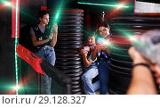 Купить «friends playing laser tag game with laser guns near tires», фото № 29128327, снято 23 августа 2018 г. (c) Яков Филимонов / Фотобанк Лори
