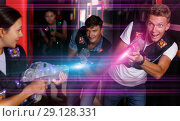 Купить «Adult man took aim and having fun with friends», фото № 29128331, снято 23 августа 2018 г. (c) Яков Филимонов / Фотобанк Лори