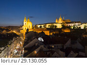 Prague, Czech Republic, Beautiful view of the night city from above. Mala Strana, church Nicholas and the Prague Castle (2018 год). Редакционное фото, фотограф Яна Королёва / Фотобанк Лори
