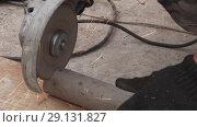 Купить «Electric circular saw cuts off metal pipe stock footage video», видеоролик № 29131827, снято 21 сентября 2018 г. (c) Юлия Машкова / Фотобанк Лори