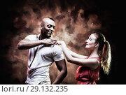 Купить «Young and sexy couple dances Caribbean Salsa», фото № 29132235, снято 22 ноября 2019 г. (c) Игорь Бородин / Фотобанк Лори