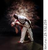 Купить «Young and sexy couple dances Caribbean Salsa», фото № 29132259, снято 22 ноября 2019 г. (c) Игорь Бородин / Фотобанк Лори