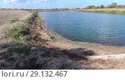 Купить «An artificial lake for fishing. A bridge for fishermen on the lake. Lake fishing.», видеоролик № 29132467, снято 25 июня 2019 г. (c) Леонид Еремейчук / Фотобанк Лори