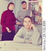 Купить «Upset woman during quarrel with family», фото № 29132899, снято 27 ноября 2017 г. (c) Яков Филимонов / Фотобанк Лори