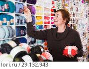 Купить «Woman choosing yarn for knitting», фото № 29132943, снято 10 мая 2017 г. (c) Яков Филимонов / Фотобанк Лори