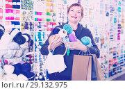 Купить «Female is standing with purchases», фото № 29132975, снято 10 мая 2017 г. (c) Яков Филимонов / Фотобанк Лори
