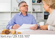 Купить «Woman and man are discussing and studying important contract», фото № 29133107, снято 21 марта 2019 г. (c) Яков Филимонов / Фотобанк Лори