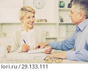 Купить «Mature married couple discuss contract and sign important documents», фото № 29133111, снято 15 октября 2018 г. (c) Яков Филимонов / Фотобанк Лори