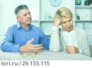 Купить «Mature couple decide family matters and find out relationship», фото № 29133115, снято 16 октября 2018 г. (c) Яков Филимонов / Фотобанк Лори