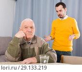 Купить «Father and son arguing», фото № 29133219, снято 26 сентября 2018 г. (c) Яков Филимонов / Фотобанк Лори