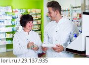 Купить «Portrait of two friendly pharmacists», фото № 29137935, снято 21 октября 2016 г. (c) Яков Филимонов / Фотобанк Лори