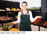 Купить «Female seller showing assortment», фото № 29138111, снято 23 ноября 2016 г. (c) Яков Филимонов / Фотобанк Лори