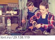 Купить «Young female is working with adjustable wrench», фото № 29138119, снято 10 октября 2017 г. (c) Яков Филимонов / Фотобанк Лори