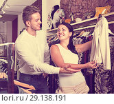 Купить «Couple purchasing jacket», фото № 29138191, снято 24 октября 2016 г. (c) Яков Филимонов / Фотобанк Лори