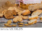 Купить «Wheat and grain baguettes, croissants and biscuits on wicker mat», фото № 29138275, снято 30 января 2018 г. (c) Яков Филимонов / Фотобанк Лори