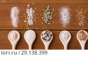 Купить «spoons with salt and spices on wooden table», видеоролик № 29138399, снято 20 сентября 2018 г. (c) Syda Productions / Фотобанк Лори