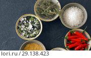 Купить «bowls with different spices on wooden table», видеоролик № 29138423, снято 20 сентября 2018 г. (c) Syda Productions / Фотобанк Лори