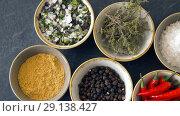 Купить «bowls with different spices on wooden table», видеоролик № 29138427, снято 20 сентября 2018 г. (c) Syda Productions / Фотобанк Лори