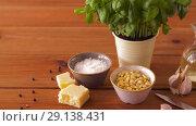 Купить «ingredients for basil pesto sauce on wooden table», видеоролик № 29138431, снято 20 сентября 2018 г. (c) Syda Productions / Фотобанк Лори