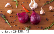 Купить «onion, garlic, chili pepper and rosemary on table», видеоролик № 29138443, снято 20 сентября 2018 г. (c) Syda Productions / Фотобанк Лори