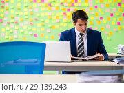 Купить «The businessman with many conflicting priorities», фото № 29139243, снято 23 мая 2018 г. (c) Elnur / Фотобанк Лори