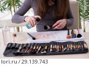 Купить «The make-up artist preparing brushes for work», фото № 29139743, снято 20 февраля 2018 г. (c) Elnur / Фотобанк Лори