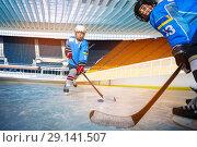 Купить «Boys passing puck during hockey training session», фото № 29141507, снято 1 декабря 2017 г. (c) Сергей Новиков / Фотобанк Лори