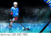 Купить «Hockey player passing the puck during competition», фото № 29141783, снято 1 декабря 2017 г. (c) Сергей Новиков / Фотобанк Лори