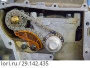 Купить «Detail of the car engine with gears and chain. Close up», фото № 29142435, снято 24 сентября 2018 г. (c) Константин Шишкин / Фотобанк Лори