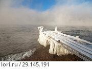 Купить «Lake Baikal on a sunny winter morning. Ice-covered boat pier near the source of the Angara River in the December frosts», фото № 29145191, снято 5 декабря 2010 г. (c) Виктория Катьянова / Фотобанк Лори