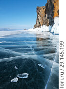 Купить «The winter landscape of the frozen Lake Baikal with blue ice and coastal cliffs on a frosty day», фото № 29145199, снято 5 марта 2011 г. (c) Виктория Катьянова / Фотобанк Лори
