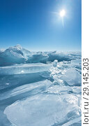 Купить «The endless field of ice hummocks on Lake Baikal in the sunny frosty day. Natural winter background», фото № 29145203, снято 26 марта 2011 г. (c) Виктория Катьянова / Фотобанк Лори
