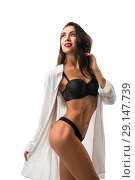 Купить «Slim brunette in black lingerie isolated view», фото № 29147739, снято 19 сентября 2018 г. (c) Гурьянов Андрей / Фотобанк Лори