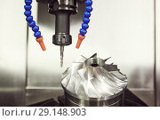 Купить «Milling metalworking process. CNC machining of turbine impeller by vertical mill», фото № 29148903, снято 16 мая 2018 г. (c) Дмитрий Калиновский / Фотобанк Лори