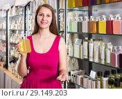 Купить «woman take a choise fresh liquid soap in perfume supermarket», фото № 29149203, снято 2 мая 2017 г. (c) Яков Филимонов / Фотобанк Лори