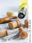 Wine stoppers, old corkscrew and a bottle of wine. Стоковое фото, фотограф Марина Сапрунова / Фотобанк Лори