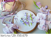 Купить «The embroidery process with satin ribbons of light-violet gladiolus flowers (These pictures of embroidery and embroidery with satin ribbons were performed by the author of the images)», фото № 29150679, снято 21 сентября 2018 г. (c) Виктория Катьянова / Фотобанк Лори