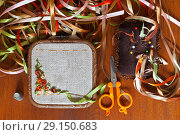 Купить «Top view of the process of hand embroidery with satin ribbons of a floral pattern (These pictures of embroidery and embroidery with satin ribbons were performed by the author of the images)», фото № 29150683, снято 27 сентября 2018 г. (c) Виктория Катьянова / Фотобанк Лори