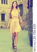 Купить «Young woman walking in historic city center», фото № 29150835, снято 26 августа 2017 г. (c) Яков Филимонов / Фотобанк Лори