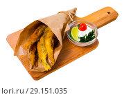 Купить «Fish and chips with creamy cheese sauce», фото № 29151035, снято 23 августа 2018 г. (c) Яков Филимонов / Фотобанк Лори