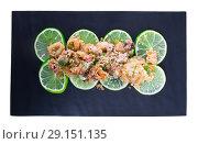 Купить «Battered calamari and cuttle with lime», фото № 29151135, снято 20 октября 2018 г. (c) Яков Филимонов / Фотобанк Лори