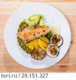 Купить «Top view of trout fillet with vegetables and dog cockles», фото № 29151327, снято 16 октября 2018 г. (c) Яков Филимонов / Фотобанк Лори
