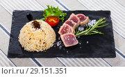 Купить «Deliciously lightly fried tuna with rice, served with greens and tomatoe», фото № 29151351, снято 23 апреля 2019 г. (c) Яков Филимонов / Фотобанк Лори