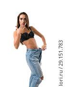 Купить «Slim girl in black bra and jeans isolated shot», фото № 29151783, снято 19 сентября 2018 г. (c) Гурьянов Андрей / Фотобанк Лори