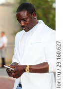 Купить «Akon attending the Fashion for Relief event during the 70th annual Cannes Film Festival, at Aeroport Cannes Mandelieu in Cannes, France. Featuring: Akon...», фото № 29160627, снято 21 мая 2017 г. (c) age Fotostock / Фотобанк Лори