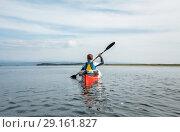 Купить «Каякер на озере Буссе, остров Сахалин», фото № 29161827, снято 29 августа 2018 г. (c) Поволкович Федор / Фотобанк Лори