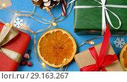 Купить «christmas gifts and decorations on blue background», видеоролик № 29163267, снято 30 сентября 2018 г. (c) Syda Productions / Фотобанк Лори
