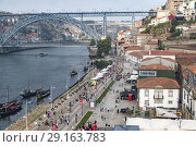 View of Oporto river and touristic walk area from funicular, Portugal. Стоковое фото, фотограф Carlos Dominique / age Fotostock / Фотобанк Лори