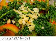 Купить «Порезанный чеснок лежит на овощном салате», фото № 29164691, снято 1 октября 2018 г. (c) Игорь Кутателадзе / Фотобанк Лори